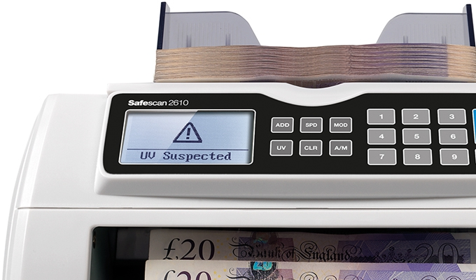 Visual and audio alert when a suspected counterfeit banknote has been detected